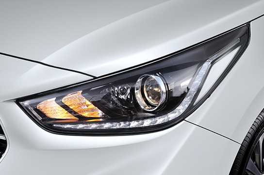 Projection headlamps with LED positioning lamps